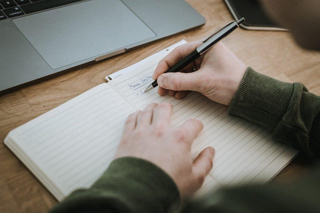 paper, book, laptop